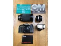 Olympus OM40 SLR. Olympus OM2 Flashgun. Olympus 50mm Lens. Vivitar 28-200 Lens