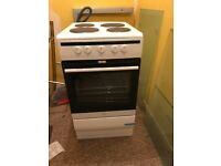 White electric 4 hob cooker with oven.