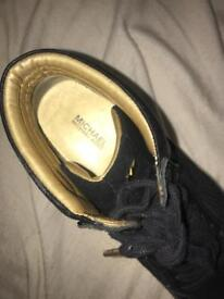 Black and gold Michael Kors high top shoes