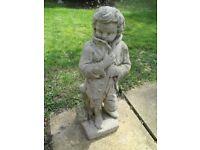 Concrete garden statue of a young man