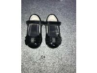 Black patent infant shoes