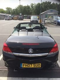 Black Vauxhall Astra convertible with satanic black alloys