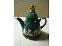 A HAPPY CHRISTMAS TEAPOT. Has a small flaw but looks fine on display.