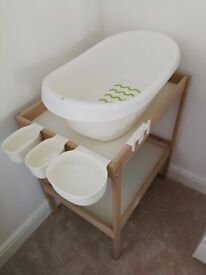 Changing table with baby bath and storage baskets