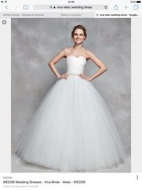 Beautiful wedding dress - never been worn- new size 12-14