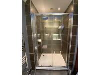Heated towel rail and shower screen