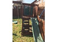 Wooden swing set, chalkboard, slide, sandpit and climbing frame