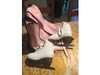 Head ice skates, white, size Euro 31, US 1. Immaculate condition - only used a few times.