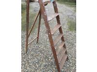 Wooden stepladder.