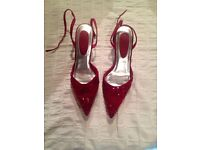 Red sequined kitten heels