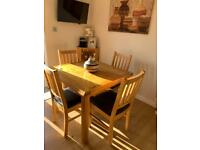 Solid oak extendable dining table & 6 chairs