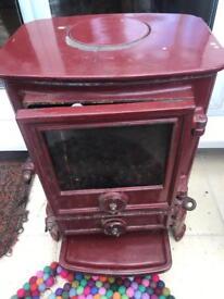 Solid iron wood burning stove
