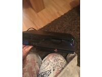 Two PlayStation 2 consoles. Controllers and games