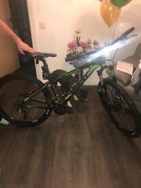 GIANT green and black bike male