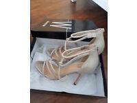 2 pairs of women heeled sandals