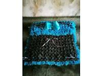 For sale dark gray and blue pom pom blanket