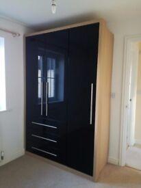 Stylish modern black wardrobe in brilliant condition