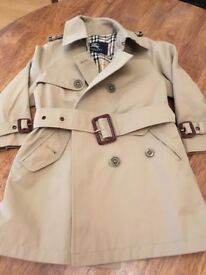 Children's Burberry coat . Age 4/5 excellent condition only worn a couple of times