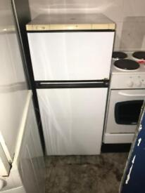 Candy fridge freezer in good working order in average condition