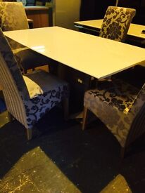 MEW stell dining table, granite top 330 and four new chairs 65 each