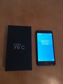 Doogee Y6 Phone with charger. 16GB. Unlocked to all networks. Bought two months ago.