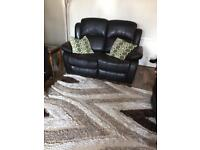 Two two seater recline sofas