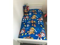 In excellent condition mattress included and 3 toddler bed sets and matching bumper