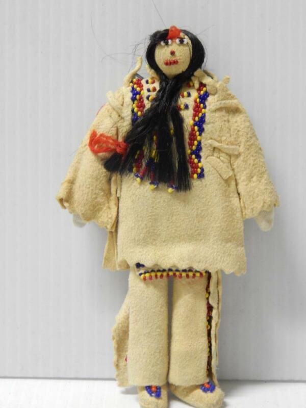 VINTAGE BEADED BLACKFEET ( PIKUNI ) INDIAN DOLL HIDE CLOTHING  3 braids MALE