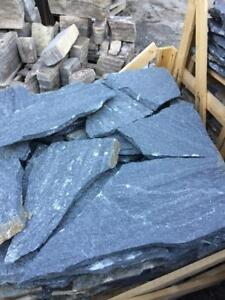 Natural stone flagstone of Quartzite and Limestone rocks. In Barrie. Colors: blue, purple, white, bronze, yellow, grey.