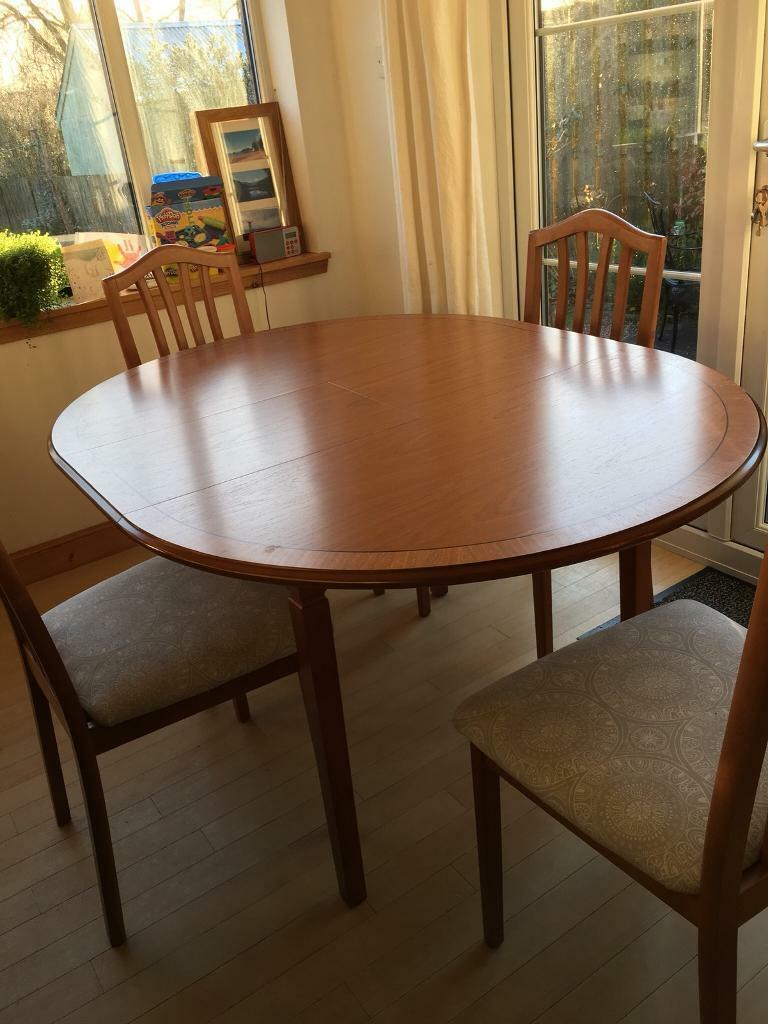 Extending Circular Dining Table And Chairs