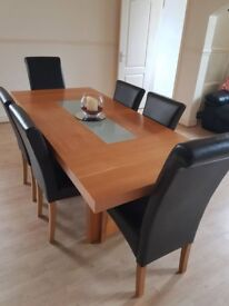 Gorgeous solid oak table and leather chairs