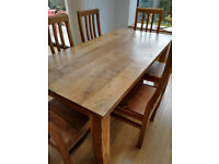 Hardwood Table and a set of 6 Chairs; used but in good condition