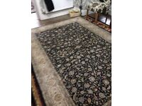 Large blue and cream rug