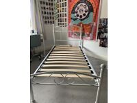 White single metal framed bed and mattress