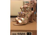 Size UK4 BRAND NEW rose gold heels with ankle ties from river island.