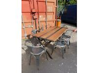 Industrial style X leg oak and steel dining table and 6 Tolix chairs