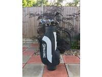 Mixed set of golf clubs including bag