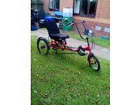 As new semi recumbent trike by mission.