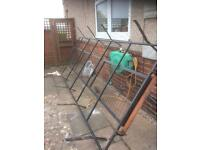 Van roof rack with door ladder