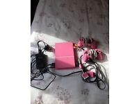 Pink ps2 console, 2 control sets with 9 games all in excellent condition