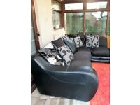 LARGE BLACK FABRIC CORNER SOFA WITH FREE DELIVERY.