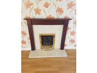 Marble gas fireplace with wooden mantle
