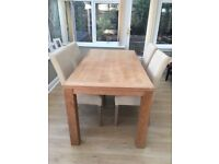 Oak table and four leather chairs