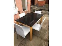 Lovely heavy granite dining Table with 4 chairs