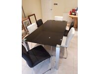 Fishpools Nepal Black Glass table with 6 chairs