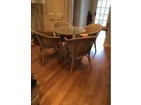 Lloyd Loom dining table and chairs