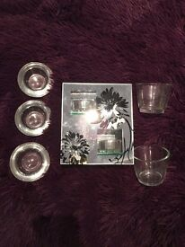 6 piece glass tea light holder set - holds 7 tealights in total. Great condition!