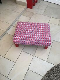 A large padded Union Jack foot stool with red legs which have padded bottom to avoid scratching
