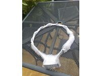 NEW. Strong netball hoop and net for wall fixing - supplied with special screws