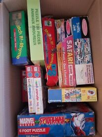 Two boxes of childrens' puzzles and games